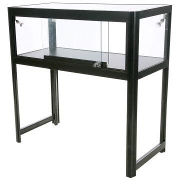 Glasmontre og vitrine disk i sort aluminium og hærdet glas<br />inkl. 4 spot og glaslåger med lås<br />mål H90xB90xD45 cm